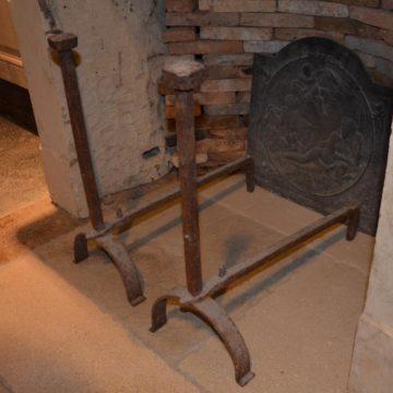 Chenet de cheminée ancien en fonte