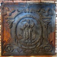 Petite plaque de cheminée ancienne en fonte