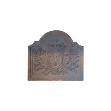plaque de cheminée avec fleurs de lys de decoration