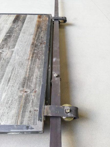 porte coulissante avec deux roues sur rail
