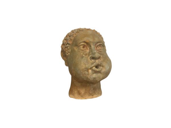 sculpture tete en pierre