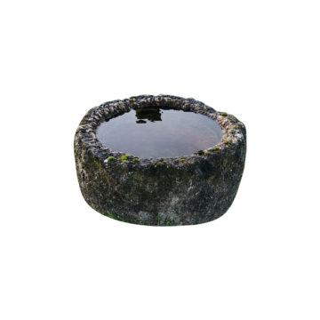 auge ronde en pierre calcaire