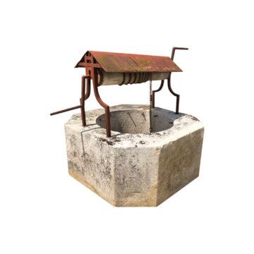 puit en pierre avec pouli